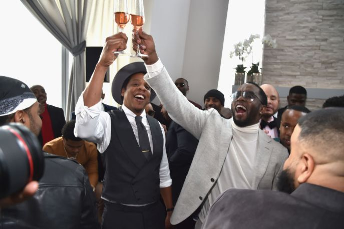 Diddy (Brother LOVE) and Jay Z have a toast.