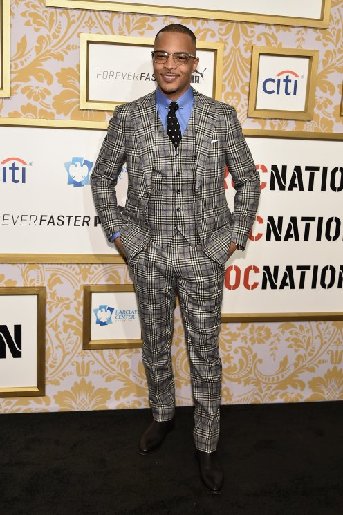 T.I. arrived in an interesting suit.